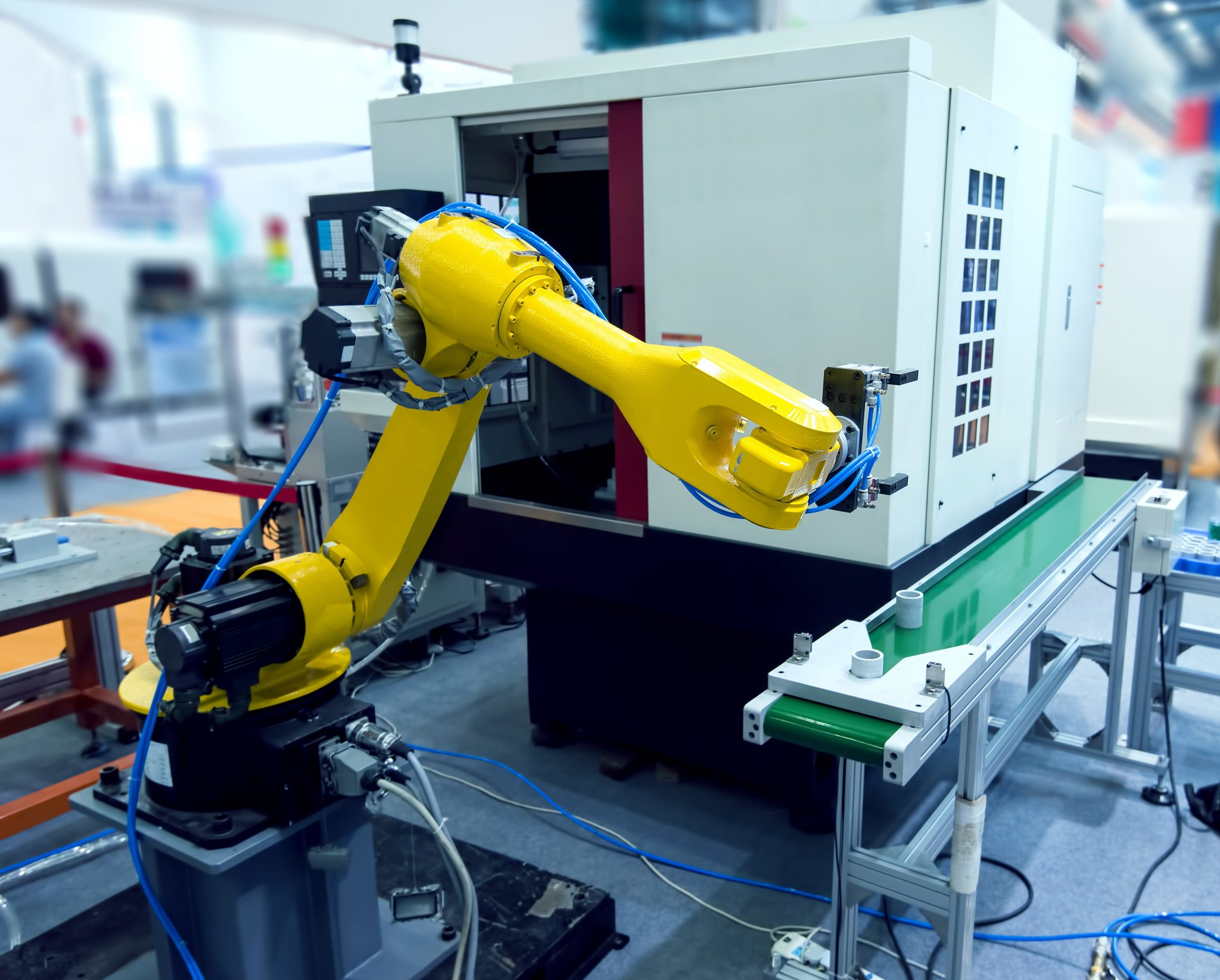 bigstock-robotic-hand-machine-tool-at-i-99370571